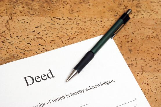 General Warranty Deed On Desk